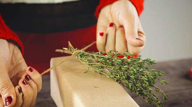 Attach some fresh herbs to the present with jute rope.