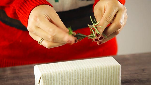 Make a wreath with the sprig of rosemary. Attach both ends together with wire.