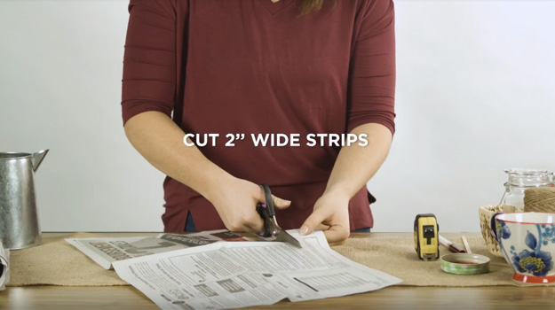 Cut two-inch-wide newspaper strips