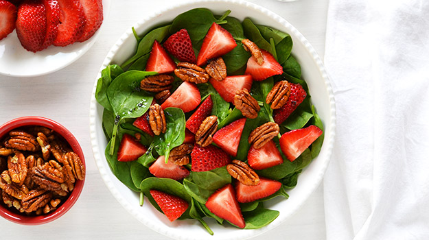 Strawberry and maple spinach salad